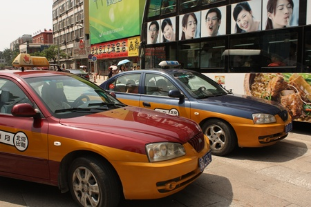 Taxi cabs in street of Beijing, China - July 20, 2010