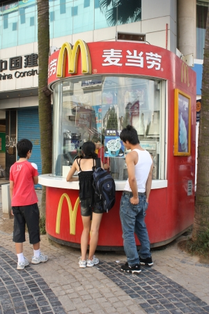 McDonalds street food kiosk with customers in Guiling, China - August 02nd, 2010