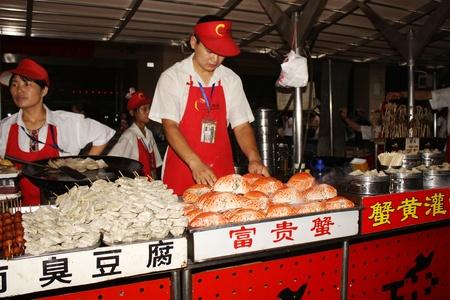 Street Food vendor in Wangfujing street in Beijing, China - July 16th, 2010