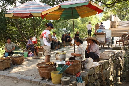 spliced: Chinese fruit market on the dragon bridge in Yangshou, China - August 04th, 2010 Editorial