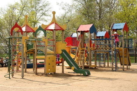 Colorful playground with playing children, Moscow, Russia - May 4, 2011
