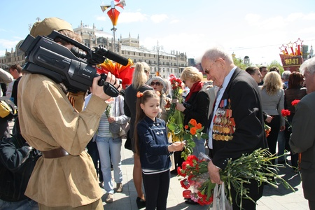 Little girl congratulates the Veteran of War -  Ð¡elebration of Victory Day in Moscow - 9th of May 2011
