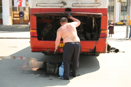 The bus is broken - Driver repairing his old broken bus and people waiting for transportation, Korolev, Russia - 20.05.2011