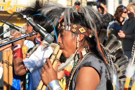 Native South American tribal group from Ecuador play Siku, andean wind musical and flutes, Moscow - 30.05.2011
