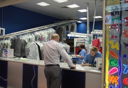 tedious: Customer making order at the dry cleaning service, Moscow, Russia - 21.06.2011
