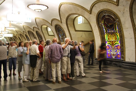 Tourist group in Moscow metro, Novoslobodskaya station, Russia 24.06.2011
