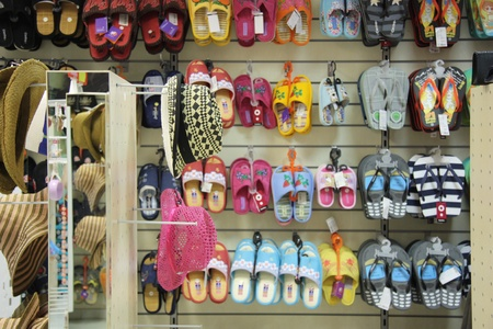 Summer accessories: slippers and straw hats in a fashion shop, Moscow, Russia - 30.06.2011