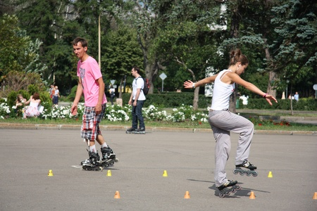 People in roller skates training in a park, Moscow, Russia, 8.07.2011