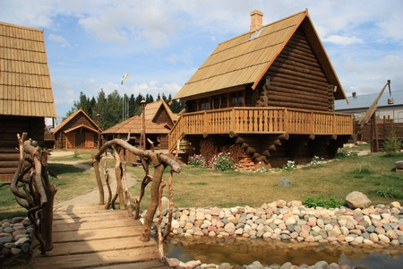 Traditional Russian wooden architecture in a thematic village photo