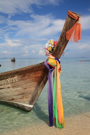 Traditional long tale boat at the beach of Phi Phi island in Thailand Stock Photo - 10404560