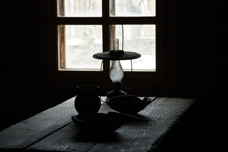 milk jugs: Village still life with kerosene lamp and wooden kitchen utensils