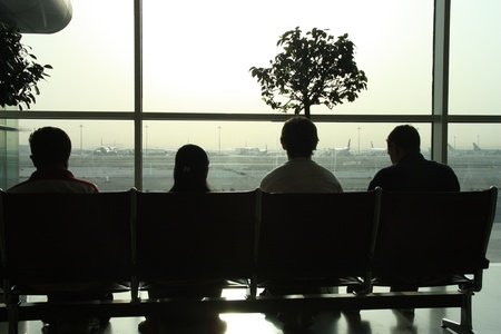 People waiting for the flight in the airport photo