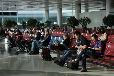 People waiting for the flight in the airport of Doha, Qatar - 21.07.2011