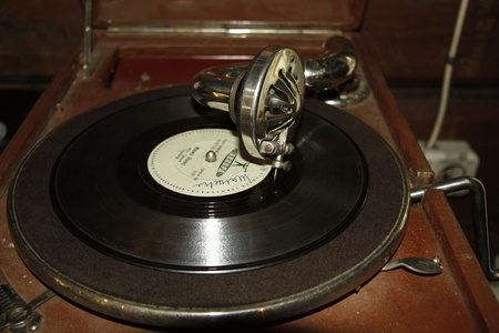 phonograph: Antique portable gramophone recording old shellac plate, Museum in Pereslavl, Russia - 21.08.2011