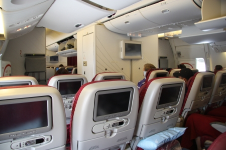 Modern plane seats with built-in screens, Qatar airlines, 20.07.2011