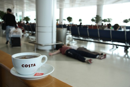 Morning tea in the airport waking up sleeping people Stock Photo - 10484428
