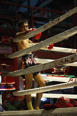 Muay Thai boxer prepares for fight at the boxing ring, Koh Phi Phi, Thailand - August 13th, 2011
