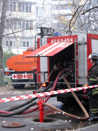 Fire-fighting vehicle and a fireman, Moscow, Russia 29.10.2011 - During the fire in a public club Octjabr