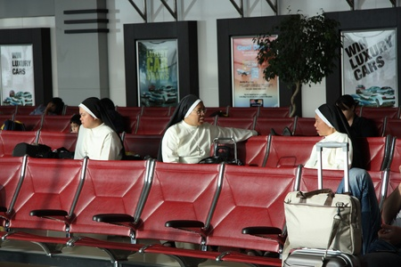 Nuns going for mission sitting in a waiting lounge in the airport of Doha, Qatar, 21.07.2011 Stock Photo - 11200785