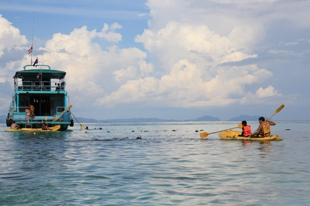 Beautiful sea landscape of Thailand island Phi Phi. People kayaking and snorkeling in a crystal water. 13.08.2011