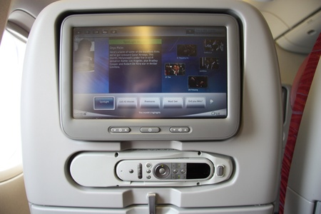 Modern plane seats with built-in screens, Qatar airlines
