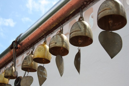 Heart bells at Buddhist temple of Thailand photo