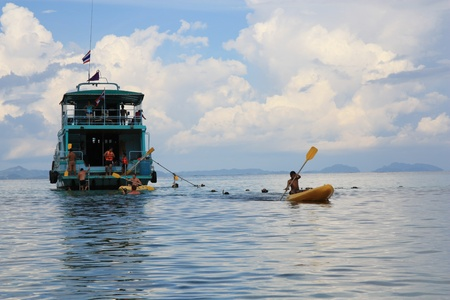 People kayaking and snorkeling in a crystal water. Beautiful sea landscape of Thailand island Phi Phi.  13.08.2011