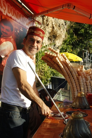 Ice cream street vendor in traditional Turkish cap in Antalya, Turkey - 29.11.11