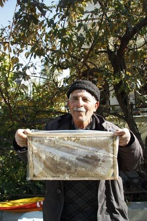 Turkish Beekeeper selling honeycomb at the market, Antalya, Turkey - 3.12.11