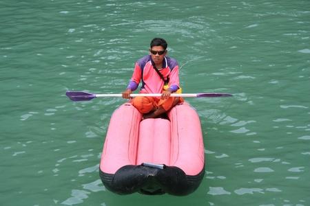 Man is kayaking at the sea, Phi Phi island, Thailand - 13.08.2011
