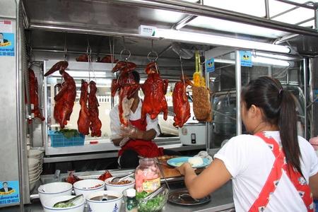Traditional Thai food at the street restaurant in Bangkok, Thailand - 22.07.2011
