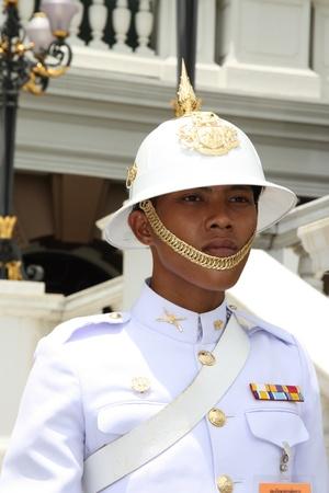 guard house: Guardian of the Royal Palace in Bangkok, Thailand - 22.07.2011