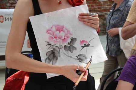 Young woman teaching traditional chinese painting Stock Photo - 11715823