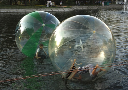 Children playing inside of floating water walking balls - 27.08.2011