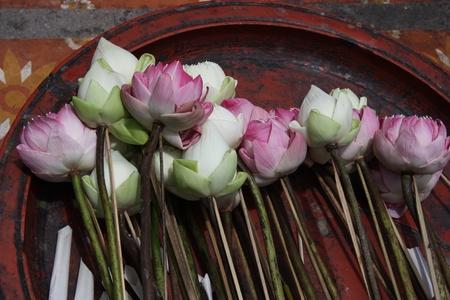 Sacrificial flowers, Thailand photo