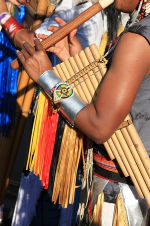 folkloristic: Native South American tribal group from Ecuador play Siku, andean wind musical and flutes