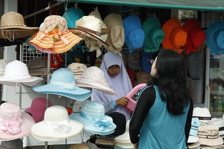 Muslim woman selling hats in Thailand - 10.08.2011