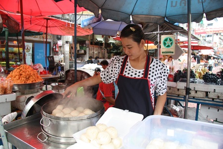 Chinese steamed bun seller in China Town in Bangkok, Thailand - 22.07.2011