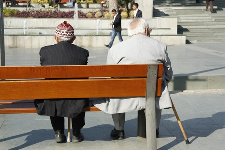 turkish man: Old people sitting on the bench, Antalya, Turkey - 29.11.2011