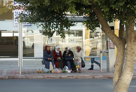 burka: Muslim women with their purchases waiting for a bus, Antalya, Turkey - 29.11.2011 Editorial