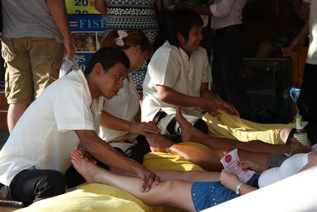 Traditional Thai foot massage in Khao San Road, Bangkok, Thailand - 25.07.2011