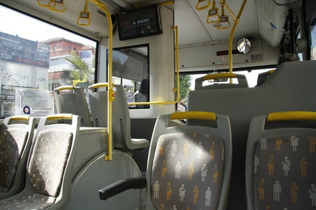 Interior of a public bus with seats for disabled people
