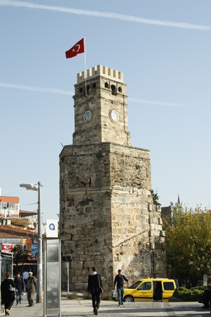Ancient clock tower in the Kaleici - historical centre of Antalya, Turkey - 30.11.2011