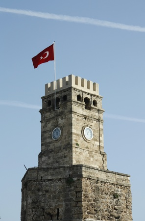 Ancient clock tower in the centre of Antalya, Turkey photo