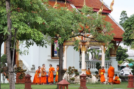 Young Buddhist monks in Thai temple Wat Phra Sing, Chiang Mai, Thailand - 26.07.2011