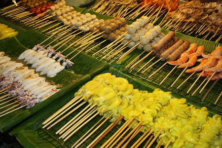 Exotic seafoods for rapid roasting at Night Market in Chiang Mai, Thailand photo