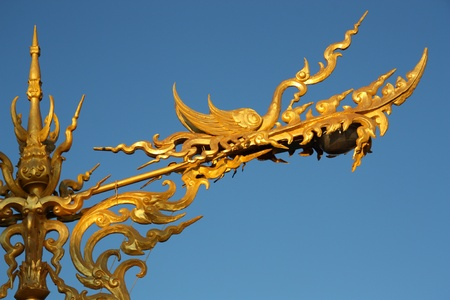 Traditional golden Thai dragon street Lamp in Chiang Rai, Thailand photo