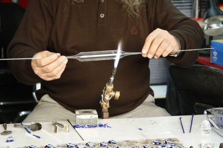 Glass blower forming a piece of glass in Turkey photo