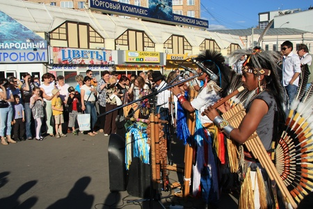 Native South American tribal group from Ecuador play Siku, andean wind musical and flutes in Moscow street, 30.05.2011 Stock Photo - 12848805