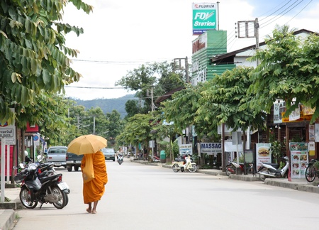 monk robe: Buddhist monk walking in Pai - Thai town very popular between young backpackers, Northern Thailand - 30.07.2011
